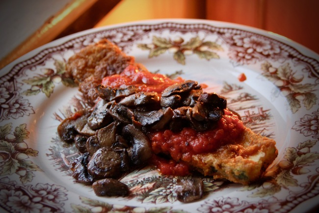 Savory crispy fried zucchini with a savory tomato and mushroom sauce.